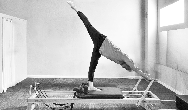 Pilates reformer pose, Pilates Works, Oakville, Ontario
